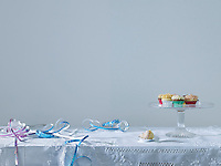 Streamers and cup cakes on table