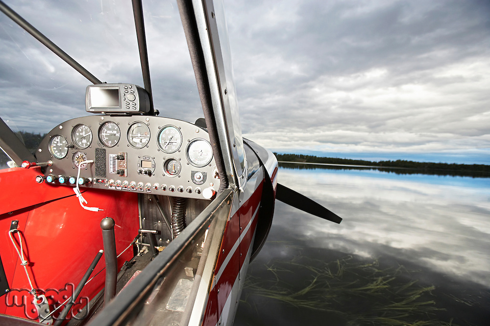 USA, Alaska, cockpit of sea plane on lake, close up