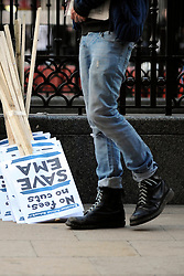 © London News Pictures. 2011/01/19 A student stands with banners. A rally and march in central London, UK, today (Wed) held by students on the day MPs are to vote on a Labour call for a rethink of the government's decision to scrap the Education Maintenance Allowance for low-income students. Picture credit should read Stephen Simpson/LNP