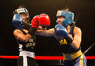 Navy's Zoe Wang, right, lands a punch to the face of Gabby Barrera, left, during the Army-Navy Boxing Classic at the Pennsylvania Convention Center on Friday night before the long-time rivalry football game. The bouts featured boxers from both academy's boxing clubs. Army was the overall winner.