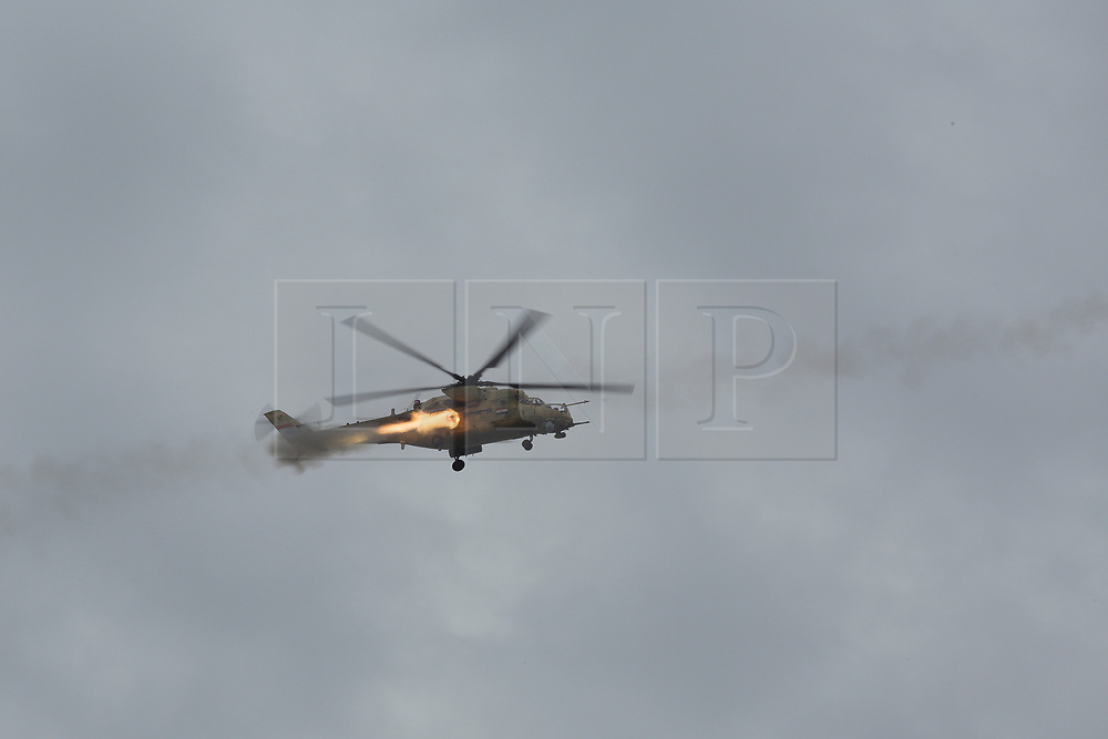 01/04/2017. Mosul, Iraq. An Iraqi Army Aviation Mi-35 Hind attack helicopter supports Iraqi ground troops by firing rockets at ISIS positions in West Mosul, Iraq.<br /> <br /> Iraqi forces reported today that one of its attack helicopters, supporting the ongoing Mosul Offensive, was shot down by Islamic State militants.