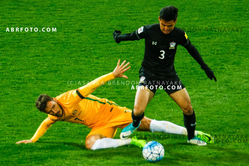 MELBOURNE, AUSTRALIA - SEPTEMBER 5 : Theerathon Bunmatan of Thailand gets tackled by Mathew Leckie of the Australia Socceroos during the Stage 3 Group World Cup Football Qualifiers between Australia Vs Thailand at the Melbourne Rectangular Stadium, Melbourne, Australia 5 September 2017.