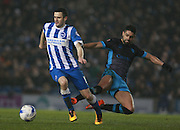 Brighton player Jamie Murphy evades a challenge from Sheffield Wednesday striker Marco Matias during the Sky Bet Championship match between Brighton and Hove Albion and Sheffield Wednesday at the American Express Community Stadium, Brighton and Hove, England on 8 March 2016. Photo by Bennett Dean.
