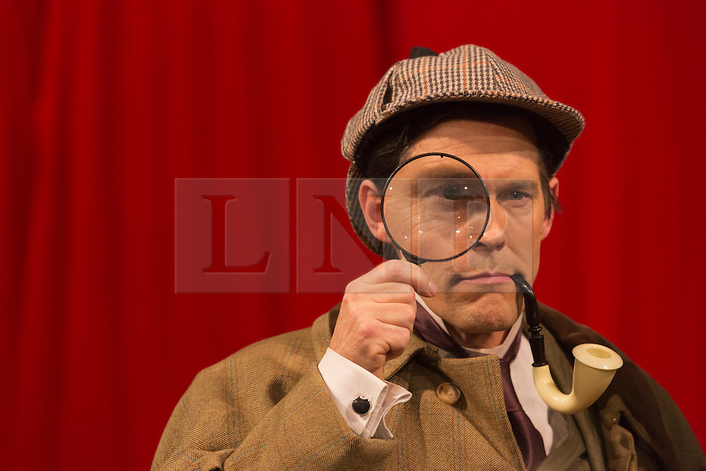"""© Licensed to London News Pictures. 28/11/2014. London, England. Toby Park as Sherlock Holmes. Spymonkey company present """"Mrs Hudson's Christmas Corker! Or 'Your Goose is Cooked Mr Holmes' ..."""" at Wilton's Music Hall, London. Written by Barry and Boy Cryer, the Christmas show takes place at 221B Baker Street with a tale based on the Sherlock Holmes legend by Sir Arthur Conan Doyle. Performances from 2 to 31 December 2014. With actors: Aitor Basauri (Dr Watson), Petra Massey (Mrs Hudson), Toby Park (Sherlock Holmes) and Sophie Russell. Photo credit: Bettina Strenske/LNP"""