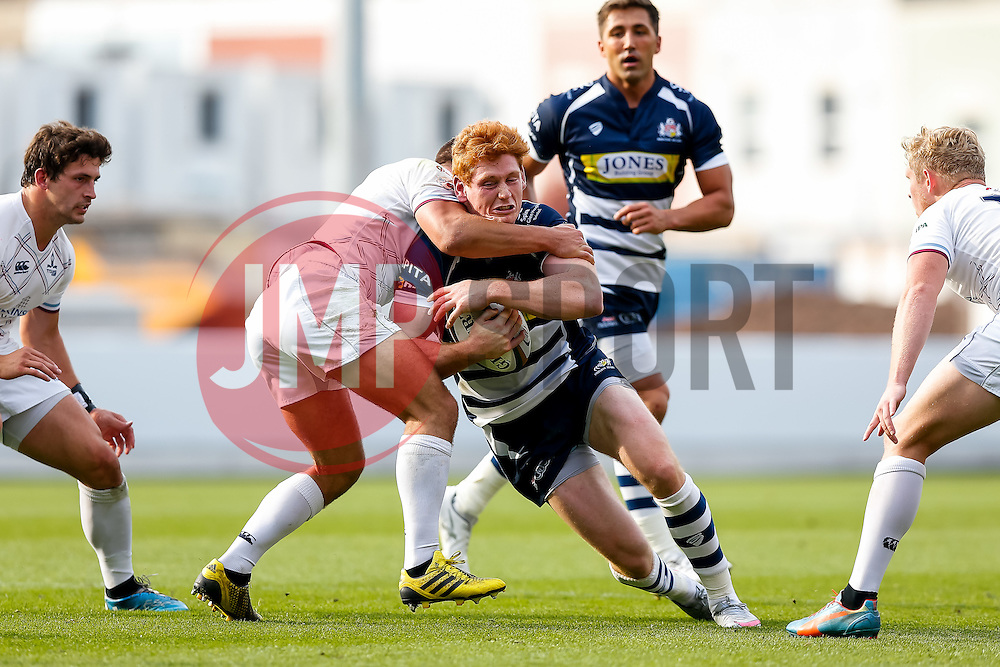 Bristol Rugby Outside Centre Jack Tovey is tackled by Rotherham Titans Winger Ben Rath - Mandatory byline: Rogan Thomson/JMP - 07966 386802 - 04/10/2015 - RUGBY UNION - Ashton Gate Stadium - Bristol, England - Bristol Rugby v Rotherham Titans - Greene King IPA Championship.
