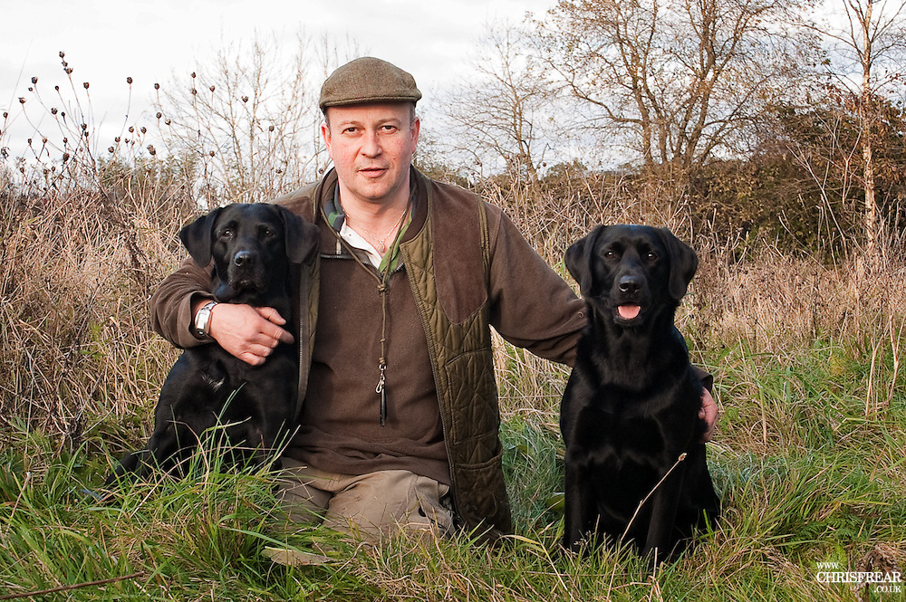 Dr Sean Henney BVM&amp;S CertSAD MRCVS.<br /> Thornhill, Dumfries<br /> with his black labrador gundogs 2008