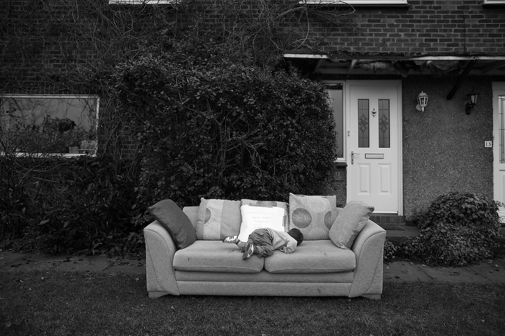 Joe climbs on to and abandoned sofa outside a home in Berkhamsted, England Wednesday, Feb. 11, 2015 (Elizabeth Dalziel) #thesecretlifeofmothers #bringinguptheboys #dailylife