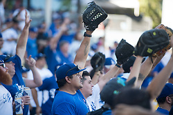 October 24, 2017 - Los Angeles, CA, USA - Dodger fans look for baseballs during the Houston Astros' batting practice before game one of the World Series at Dodger Stadium on Tuesday, Oct. 24, 2017 in Los Angeles, CA on Tuesday, October 24, 2017. (Credit Image: © Kevin Sullivan/Los Angeles Daily News via ZUMA Wire)