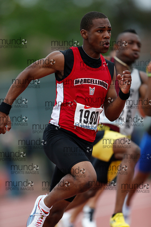 Deion Barker of St Marcellinus SS -Mississauga competes in the 200m heats at the 2013 OFSAA Track and Field Championship in Oshawa Ontario, Saturday,  June 8, 2013.<br /> Mundo Sport Images/ Geoff Robins