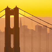 Golden Gate Bridge at sunrise with San Francisco California skyline in background