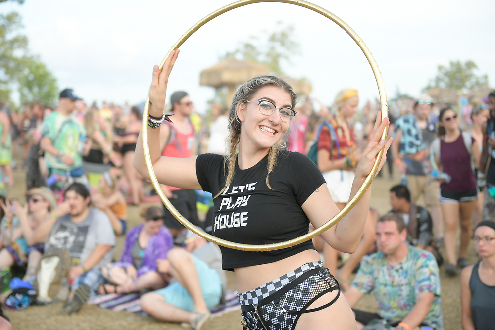 A hoolahooper poses for a photo in between sets during The Bonnaroo Music and Arts Festival in Manchester, TN