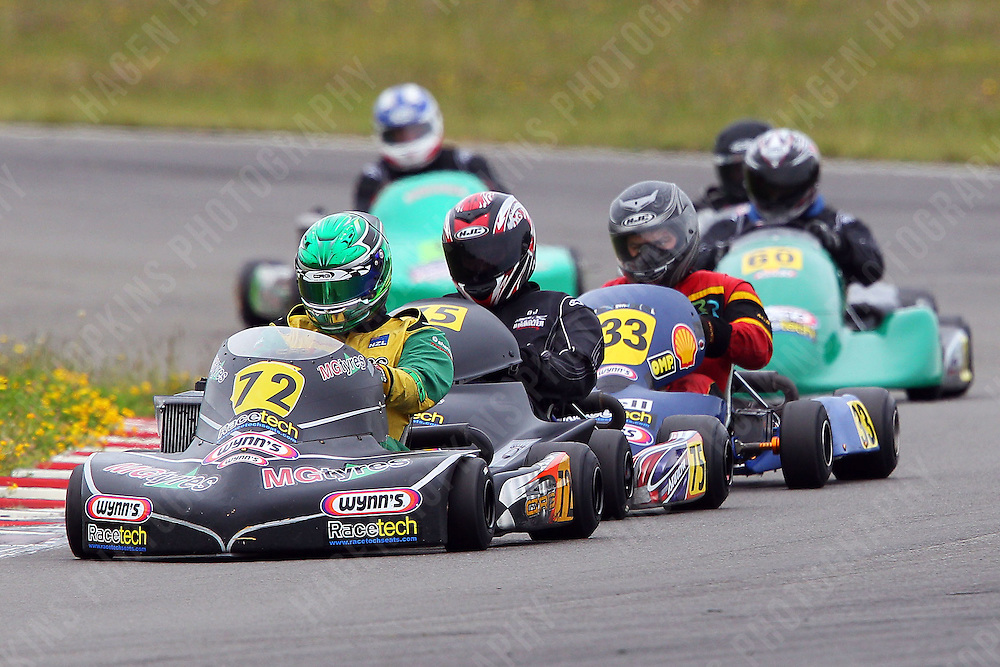 Aarron Cunningham, 72, Daniel Sayles, 75, and Sean Cuthbert, 33, race in the Rotax Heavy class during the 2012 Superkart National Champs and Grand Prix at Manfeild in Feilding, New Zealand on Saturday, 7 January 2011. Credit: Hagen Hopkins.