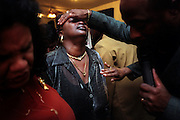 Pastor Willie L. King, right, lays hands on a member of the Showers of Blessings Harvest Center, a non-denominational church, during a Sunday morning service in Gainesville, Fla., in 2003.