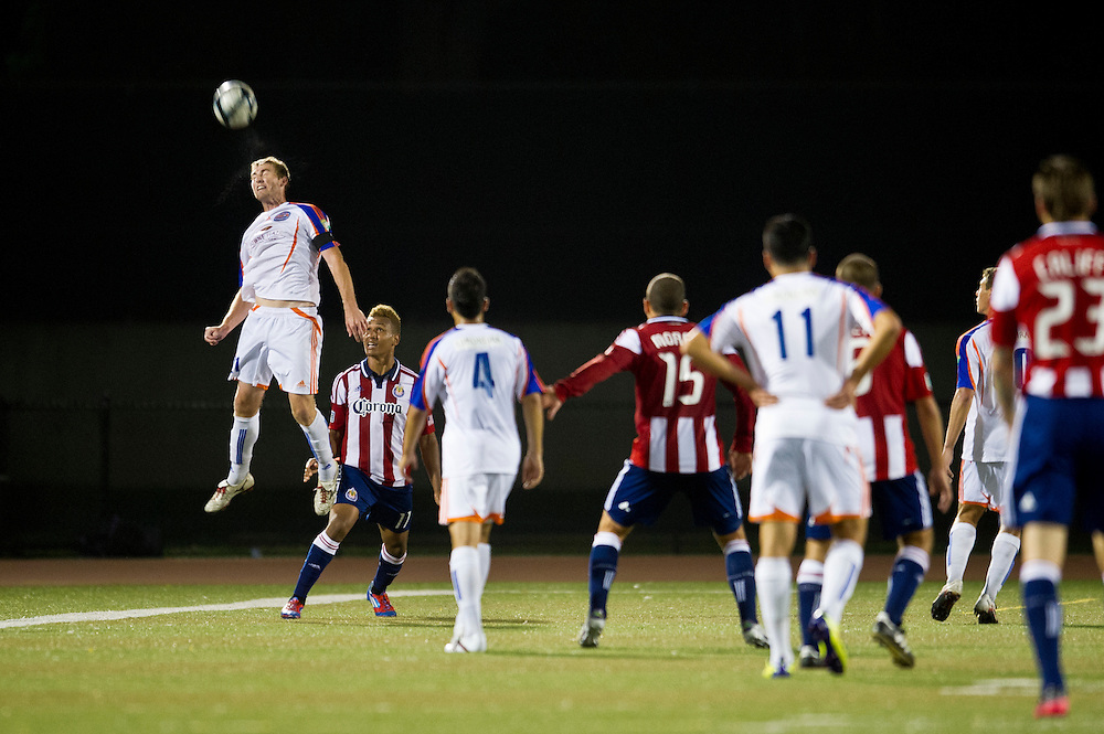 Mickey Daly of the Ventura County Fusion with a header late into the game during a match vs. Chivas USA at Ventura College in Ventura Calif., on May 29, 2012.  Chivas went on to win the game 1-0.  (Photo by Aaron Schmidt © 2012)