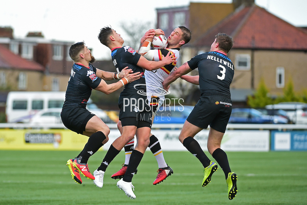 Bradford Bulls right centre James Mendeika (3) tackled by three Broncos during the Kingstone Press Championship match between London Broncos and Bradford Bulls at Trailfinders Sports Club, Vallis Way, United Kingdom on 5 March 2017. Photo by Jon Bromley.