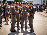 04 DECEMBER 2013 - BANGKOK, THAILAND:  Senior commanders of the Royal Thai Police wait for protestors during an antigovernment protest at police headquarters in Bangkok. Several hundred anti-government protestors tried to occupy Royal Thai Police Headquarters on Rama I Road in central Bangkok Wednesday. The protest was one of the continuing protests against the government of Prime Minister Yingluck Shinawatra. Police commanders allowed protestors to tear down police barricades and ordered riot police to lay down their shields. Protestors then chanted anti-government slogans and called on police to turn against the government before forming a motorcade and leaving the area. Anti-government protests have gripped Bangkok for nearly a month and protestors vow to continue their actions. Protests Wednesday were much smaller and more peaceful than protests earlier in the week.     PHOTO BY JACK KURTZ