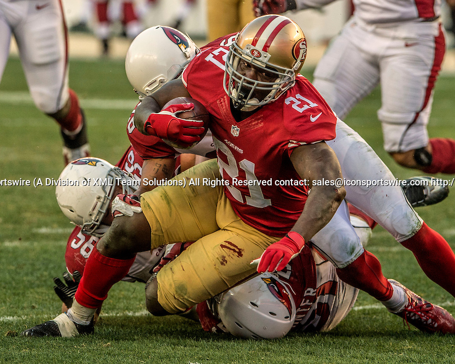 December 28, 2014: San Francisco 49ers running back Frank Gore (21) record breaking run on Sunday, December 28, 2014, at Levis Stadium in Santa Clara, California. The 49ers defeated the Cardinals 20-17.