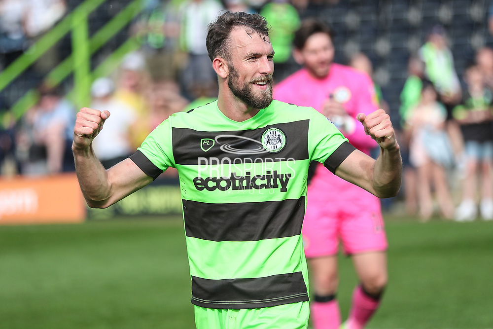Forest Green Rovers Christian Doidge(9) applauds the fans at the final whistle during the EFL Sky Bet League 2 match between Forest Green Rovers and Cambridge United at the New Lawn, Forest Green, United Kingdom on 22 April 2019.