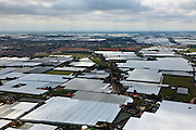 Nederland, Zuid-Holland, Gemeente Westland,  22-05-2011; Westland, kassengebied met de bebouwing van Naaldwijk en 's-Gravenlande. Regenbui aan de horizon.Greenhouse area between The Hague and Rotterdam..luchtfoto (toeslag), aerial photo (additional fee required).copyright foto/photo Siebe Swart