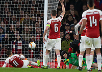 Football - 2018 / 2019 UEFA Europa League - Round of Sixteen, Second Leg: Arsenal (1) vs. Rennes (3)<br /> <br /> Petr Cech (Arsenal FC) gets a shin in the face as he rushes to intercept Adrien Hunou (Rennes FC) at The Emirates.<br /> <br /> COLORSPORT/DANIEL BEARHAM