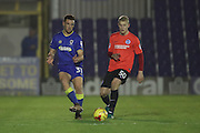 Seth Owens and Brighton & Hove Albion midfielder Henrik Bjordal (50) during the EFL Trophy match between AFC Wimbledon and U23 Brighton and Hove Albion at the Cherry Red Records Stadium, Kingston, England on 6 December 2016.