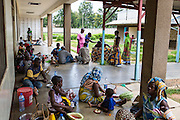 Family members and patients sitting in the garden area outside the children's ward. St Walburg's Hospital, Nyangao. Lindi Region, Tanzania.