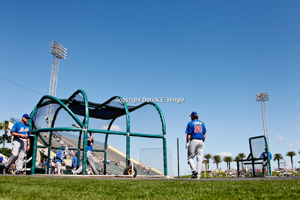 March 14, 2012; Lakeland, FL, USA; New York Mets right fielder Mike Baxter (23) hits during batting practice before a spring training game against the Detroit Tigers at Joker Marchant Stadium. Mandatory Credit: Derick E. Hingle-US PRESSWIRE