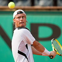 04 June 2007: Australian player Lleyton Hewitt eyes the ball as he prepares a backhand shot to Spanish player Rafael Nadal during the French Tennis Open fourth round match won 6-3, 6-1, 7-6 (7/5) by Rafael Nadal over Lleyton Hewitt on day 9 at Roland Garros, in Paris, France.