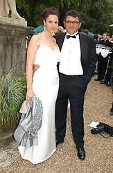 MR VINCENT TCHENGUIZ and MISS MELISSA MONTEZANI at a fund raising event for The Galapagos Conservation Trust entitled 'Some Enchanted Evening' at the Chelsea Physic Garden Chelsea, London on 17th June 2004.