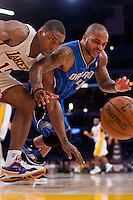 02 December 2012: Forward (1) Meta World Peace of the Los Angeles Lakers reaches for a loose ball with Jameer Nelson of the Orlando Magic during the second half of the Magic's 113-103 victory over the Lakers at the STAPLES Center in Los Angeles, CA.