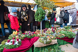 Christmas decorations and wreaths for sale at weekend market in Kollwitzplatz Prenzlauer Berg , Berlin, Germany