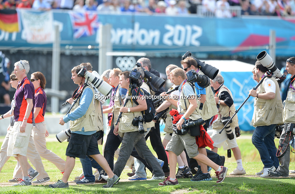 Photographers are escourted to the medal ceremony during the Men's C2 Canoe Slalom at the Lee Valley Whitewater Centre, London, United Kingdom. Thursday 2 August 2012. Photo: Andrew Cornaga/Photosport.co.nz
