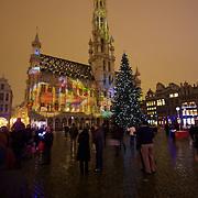 The Bruxelles Town Hall lit up for the Christmas light and sound show, with the city Christmas tree taking center stage in the Grand Place