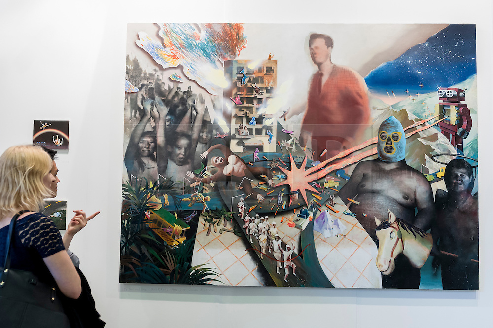 "© Licensed to London News Pictures. 19/05/2016. London, UK. Visitors look at Lai Wei-Yu's ""It's the Final Boss"".  Art16 opens at Olympia, in west London.  Now in its fourth edition, the fair brings together over 100 galleries from more than 30 countries showcasing a diverse cross-section of work by contemporary artists from around the world for buyers and art enthusiasts to visit. Photo credit : Stephen Chung/LNP"