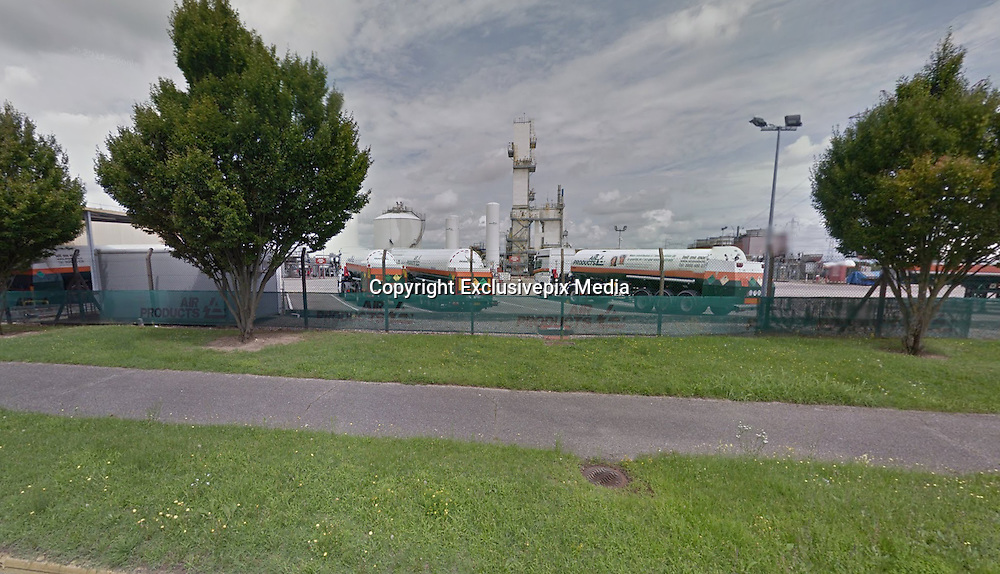 Man decapitated as severed head is 'covered in Arabic writing' and hung on a fence next to Islamist flag at factory in France after terrorists storm building and set off 'gas bomb' explosions<br /> <br /> A man has been decapitated and dozens more injured at a gas product factory in France by terrorists carrying Islamist banners.<br /> The attack took place at the headquarters of the American owned Air Products, in Saint-Quentin-Fallavier, near the city of Lyon, in the south east of the country.<br /> The murder is believed to have been accompanied by several explosions on the site when the terrorists ignited small 'gas bombs', causing injuries to dozens of factory workers.<br /> The murdered man's head is understood to have been found 30 feet away from his body, hanging on the factory's fence. The dead man's head was covered in Arabic 'inscriptions' before being placed on the fence, according to local journalists at the scene.<br /> Local media reported that a 30-year-old man 'known to security services' has already been arrested at the scene, telling police officers that he is a member of the Islamic State terror group. The second terrorist is believed to have gone on the run.<br /> <br /> Witnesses at the scene claimed there more than one man was involved in the attack and that the perpetrators were carrying Islamist flags. <br /> Two men were seen driving into the main gate soon after 10am, before driving around in circles throwing gas cylinders around the main yard. One of the men then jumped out of the car, according to local prosecuting sources, and then 'decapitated a man'.<br /> Before the attack a man was seen driving back and forth outside the factory, according to Dauphiné Libéré. <br /> An Islamic flag – possibly that of Islamic State – was found next to the dead body. The man's head was found some 30 feet from the corpse.<br /> French journalist Stefan Vries told Sky News: 'There was an explosion at a gas factory. Several people were wounded and there 