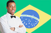 Portrait of mixed race man against Brazilian flag