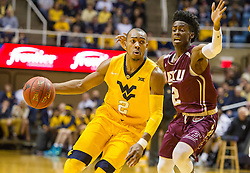 Dec 21, 2015; Morgantown, WV, USA; West Virginia Mountaineers guard Jevon Carter (2) dribbles past Eastern Kentucky Colonels guard Paul Jackson (2) during the first half at the WVU Coliseum. Mandatory Credit: Ben Queen-USA TODAY Sports