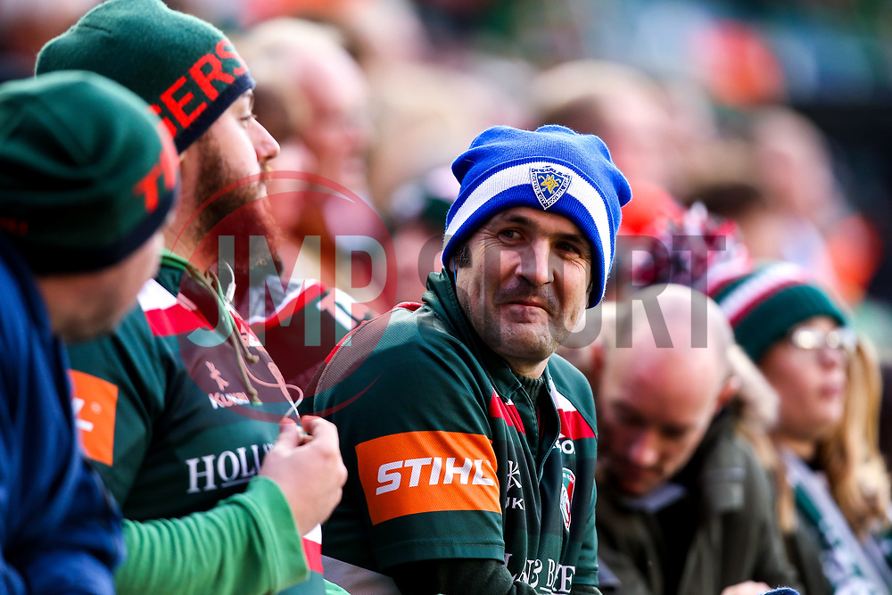 Leicester Tigers fans wears a Leicester City hat in tribute to Leicester City Chairman Vichai Srivaddhanaprabha who passed away in a helicopter crash - Mandatory by-line: Robbie Stephenson/JMP - 03/11/2018 - RUGBY - Welford Road Stadium - Leicester, England - Leicester Tigers v Worcester Warriors - Gallagher Premiership Rugby