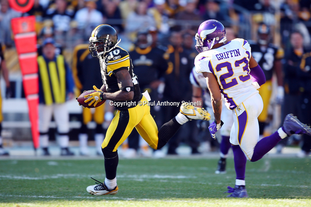 Pittsburgh Steelers wide receiver Santonio Holmes (10) catches a fourth quarter pass that gives the Steelers first and goal while being chased by Minnesota Vikings cornerback Cedric Griffin (23) during the NFL football game, October 25, 2009 in Pittsburgh, Pennsylvania. The Steelers won the game 27-17. (©Paul Anthony Spinelli)