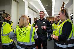 "© Licensed to London News Pictures . 18/12/2015 . Manchester , UK . Newly appointed Chief Constable IAN HOPKINS speaks to volunteer "" Street Angels "" at a police briefing ahead of the evening . Revellers in Manchester enjoy "" Mad Friday "" - also known as "" Black Eye Friday "" - the day on which emergency services in Britain are typically at their busiest , as people head out for parties and drinks to celebrate Christmas . Photo credit : Joel Goodman/LNP"