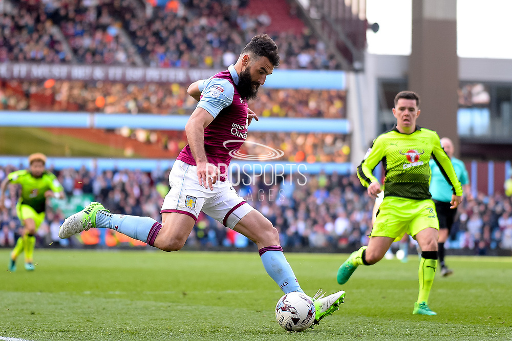 Aston Villa midfielder Mile Jedinak (25) crosses during the EFL Sky Bet Championship match between Aston Villa and Reading at Villa Park, Birmingham, England on 15 April 2017. Photo by Dennis Goodwin.