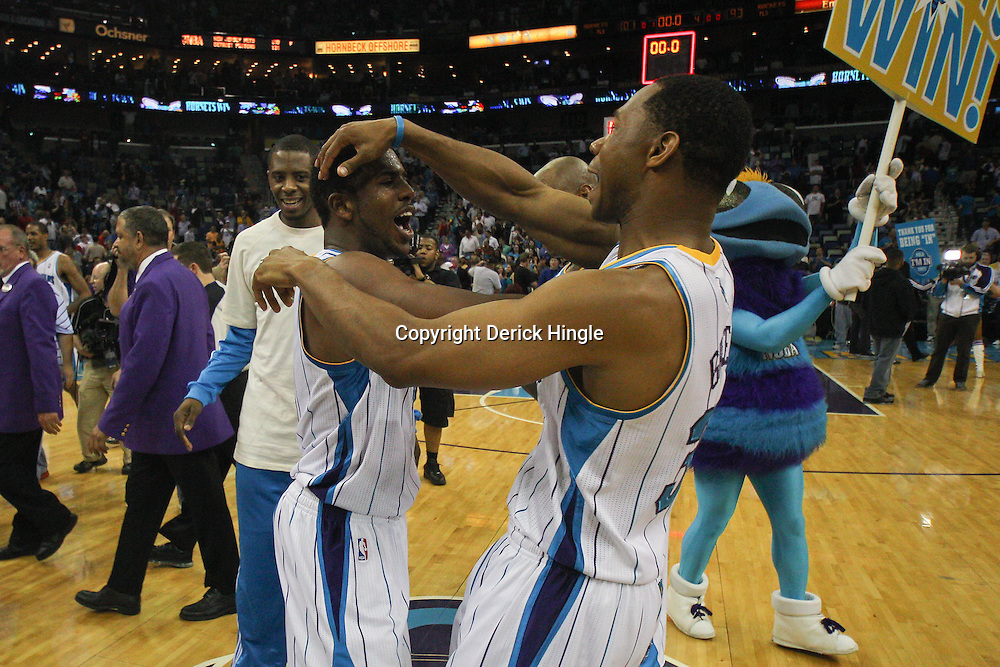 April 6, 2011; New Orleans, LA, USA; New Orleans Hornets point guard Chris Paul (3) and shooting guard Willie Green (33) celebrate following a win over the Houston Rockets at the New Orleans Arena. The Hornets defeated the Rockets 101-93 and clinched a playoff spot with the victory.   Mandatory Credit: Derick E. Hingle-US PRESSWIRE