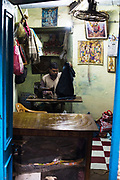 A Tailor working at his tailorshop in Varanasi, India