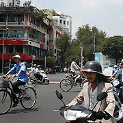 A street scene showing scooters and bikes in Ho Chi Minh City, Vietnam. 3rd March 2012. Photo Tim Clayton