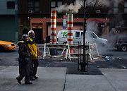 © Licensed to London News Pictures. 05/01/2013. New York City, USA .  A man and woman walk past steam escaping into the street. Photo credit : Stephen Simpson/LNP
