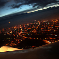 Lights from the capital city can be seen from a departing jetliner as dawn breaks over Quito, Ecuador, on June 18, 2009. Quito and Guayaquil are the only two available routes for tourists to fly to the Galapagos Islands off the coast.