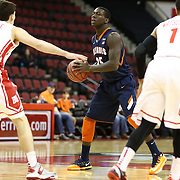 Kendrick Nunn #25 of the Illinois Fighting Illini looks to pass the ball during the NIT First Round game at Agganis Arena on March 19, 2014 in Boston, Massachusetts . (Photo by Elan Kawesch)