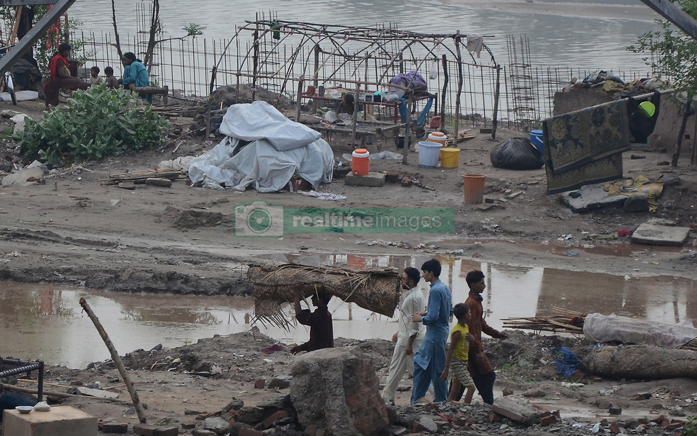 July 31, 2017 - Lahore, Punjab, Pakistan - Pakistani gypsy families on the bank of river after warning issued by the local administration due to water level increased in River Ravi after recent monsoon spell in Lahore. (Credit Image: © Rana Sajid Hussain/Pacific Press via ZUMA Wire)