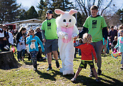 The Easter Bunny arrives and gives high fives during the 21st Annual Easter Egg Hunt at Winnequah Park in Monona, WI on Saturday, April 20, 2019.