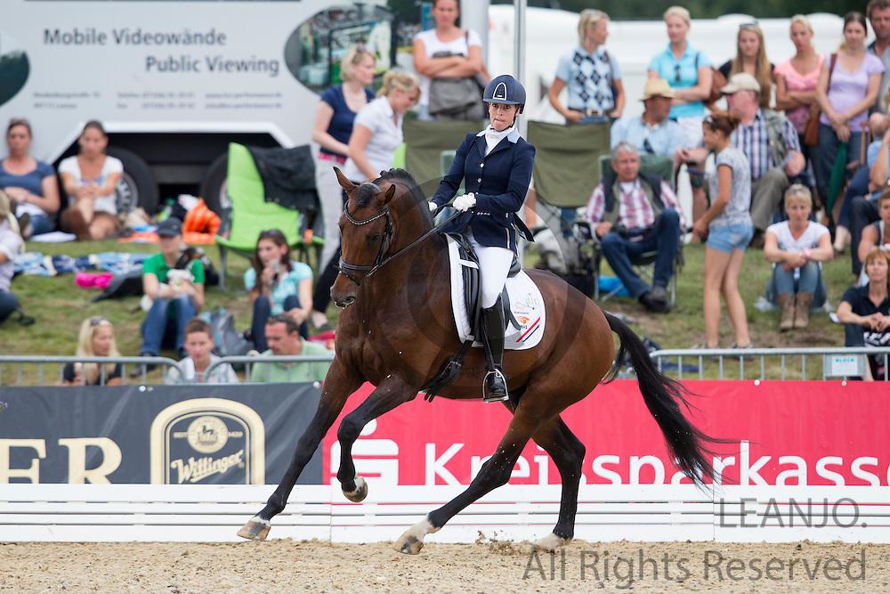 Mirelle van Kemenade Witlox - Decor Cachet L<br /> FEI World Breeding Dressage Championships for Young Horses 2012<br /> © DigiShots